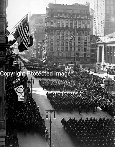 Overseas men welcomed home.  Parade in honor of returned fighters passing the Public Library, N.Y. City.  1919.  Paul Thompson. (War Dept.)<br />Exact Date Shot Unknown<br />NARA FILE #:  165-WW-127-27<br />WAR & CONFLICT BOOK #:  720