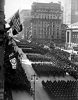 Overseas men welcomed home.  Parade in honor of returned fighters passing the Public Library, N.Y. City.  1919.  Paul Thompson. (War Dept.)<br />