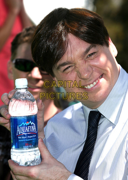 "MIKE MYERS.Attending ""Shrek the Third"" Los Angeles Premiere at Mann's Village Theatre, Westwood, California, USA, .6 May 2007 .portrait headshot funny face holding water bottle drink Aquafina.CAP/ADM/BP.©Byron Purvis/AdMedia/Capital Pictures."