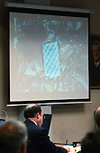 A Tarot card found at the shooting scene in the wooded area near Benjamin Tasker Middle School in Bowie Maryland, is displayed on a screen above defense attorney Peter Greenspun during testimony in the trial of sniper suspect John Allen Muhammad in courtroom 10 at the Virginia Beach Circuit Court in Virginia Beach, Virginia on October 30, 2003. <br /> Credit: Adrin Snider - Pool via CNP