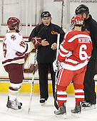 Joe Whitney (BC - 15) and Joe Pereira (BU - 6) meet with John Gravallese and Jack Millea. - The Boston College Eagles defeated the visiting Boston University Terriers 5-2 on Saturday, December 4, 2010, at Conte Forum in Chestnut Hill, Massachusetts.
