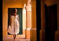A woman stands at an open archway inside of the historic Fort Christiansted in the US Virgin Islands