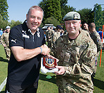 Rangers army visit in Germany - Ally McCoist is presented with a plaque from the Royal Scots Dragoon Guards