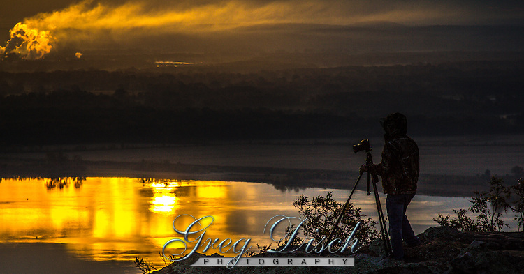 Sunrise over the Arkansas River as seen from the Petit Jean Gravesite Overlook at Petit Jean State Park near Morrilton Arkansas.
