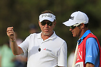 Miguel Angel Jimenez (ESP) and caddy Cliff Botha on the 14th green during Thursday's Round 1 of the 145th Open Championship held at Royal Troon Golf Club, Troon, Ayreshire, Scotland. 14th July 2016.<br /> Picture: Eoin Clarke | Golffile<br /> <br /> <br /> All photos usage must carry mandatory copyright credit (&copy; Golffile | Eoin Clarke)
