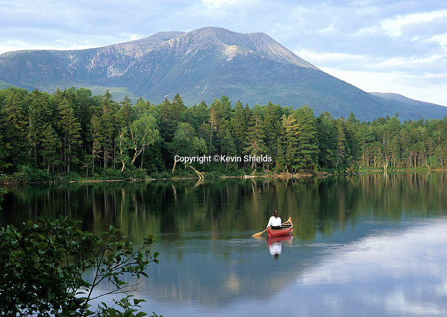 Woman canoeing on Kidney Pond, Baxter State Park, Maine, USA