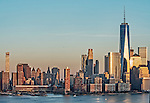 View of the Freedom Tower and nearby buildings at sunset, from across the Hudson River in Jersey City