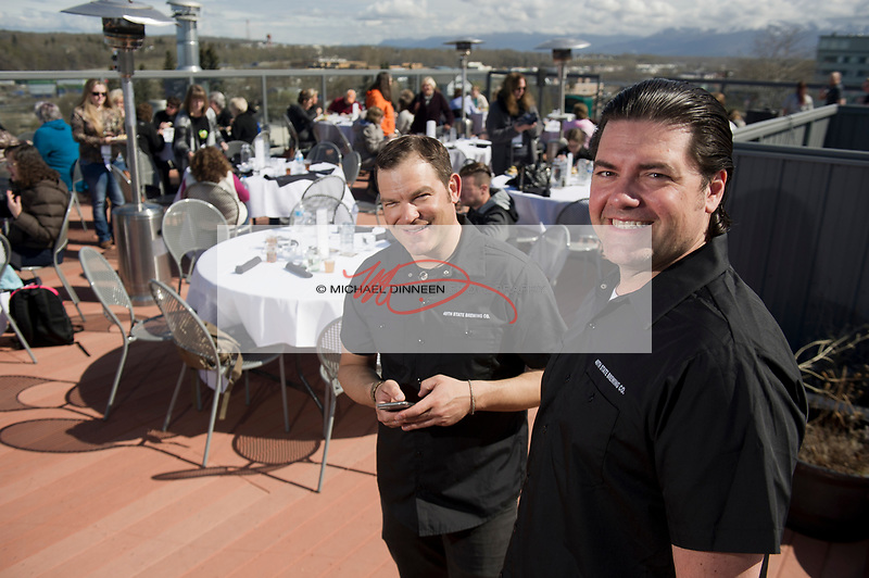 From left, Justin Matyka and David McCarthy, owners of 49th State Brewery, on the upper deck of their Third Ave. restaurant in downtown Ancchorage.  Photo for the Journal of Commerce by Michael Dinneen