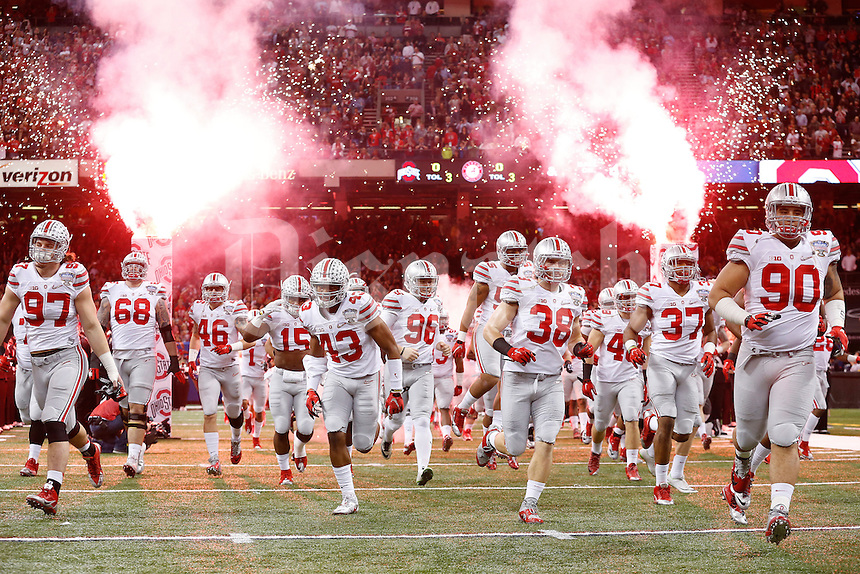 Ohio State players take the field prior to the Allstate Sugar Bowl college football playoff semifinal against the Alabama Crimson Tide at the Mercedes-Benz Superdome in New Orleans on Jan. 1, 2015. (Adam Cairns / The Columbus Dispatch)