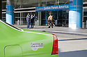 A green Honda natural gas vehicle (NGV) parked at Moscone Center in San Francisco during the Carbon Forum America event in 2008. The car has a clean air vehicle sticker which allows it to be used in a carpool lane. The vehicle promotes PG&E (Pacific Gas and Electric Company) campaign featuring letsgreensthiscity.com. San Francisco, California, USA