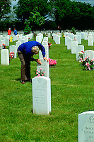 Older gentleman paying respects at Fort Snelling Military Cemetery Age 70.  Minneapolis Minnesota USA