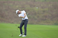 Chris Kirk (USA) plays his 2nd shot on the 11th hole during Friday's Round 2 of the 2014 BMW Masters held at Lake Malaren, Shanghai, China 31st October 2014.<br /> Picture: Eoin Clarke www.golffile.ie