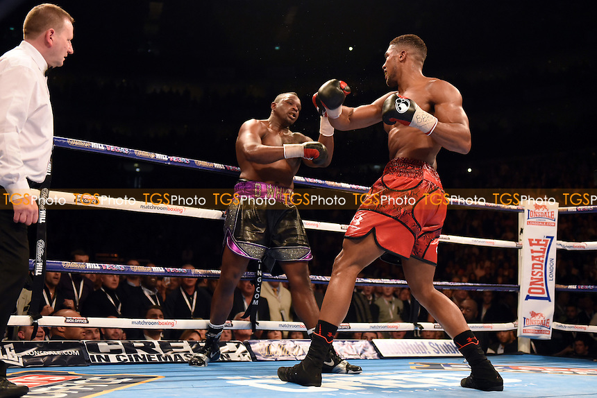 Anthony Joshua (red shorts) defeats Dillian Whyte to win the British, Commonwealth and WBC International Heavyweight Titles at the O2 Arena, London