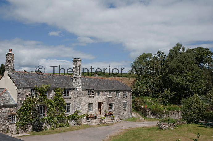 The property is a traditional Devon longhouse and is surrounded by 11 acres of land