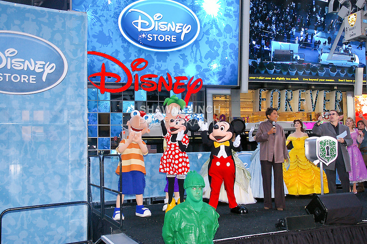 Disney characters attend the Disney Store grand opening in Times Square, November 9, 2010.