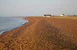 Housing on beach at small coastal hamlet of Shingle Street, North Sea coast, Suffolk, England, UK