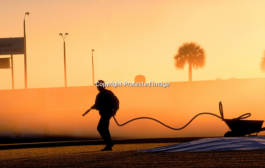 Grounds keeper during early morning. Ft. Myers, Florida.Photo by Chris Covatta