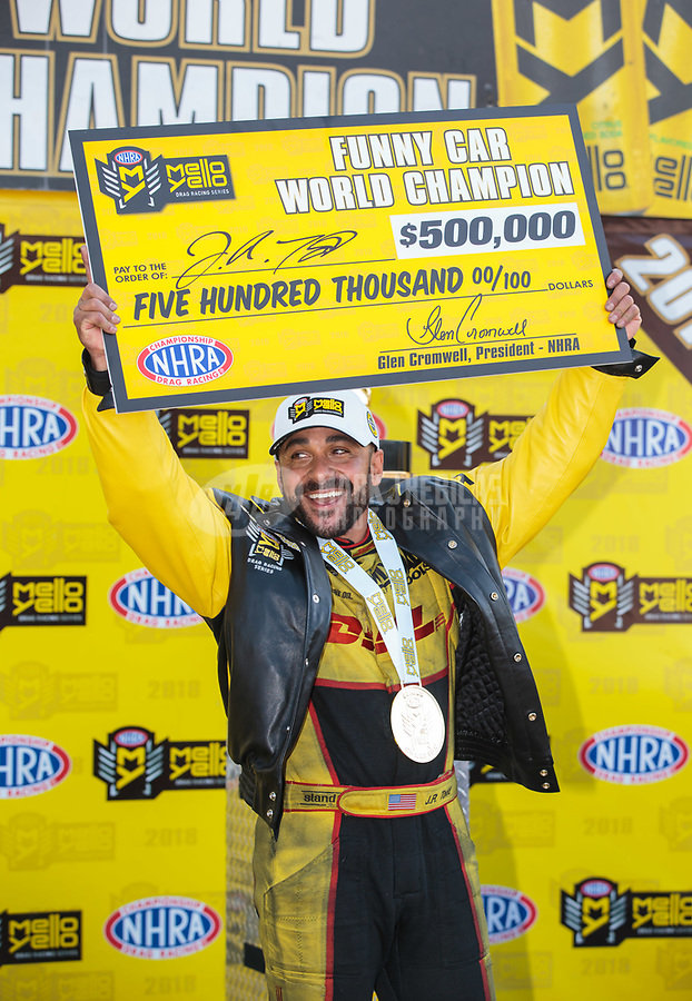 Nov 11, 2018; Pomona, CA, USA; NHRA funny car driver J.R. Todd celebrates after clinching the 2018 funny car world championship during the Auto Club Finals at Auto Club Raceway. Mandatory Credit: Mark J. Rebilas-USA TODAY Sports
