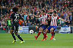 Atletico de Madrid´s Diego Godin (L) and Gabi and  Chelsea´s Fernando Torres during Champions League semifinal first leg soccer match between Atletico de Madrid and Chelsea, at the Vicente Calderon stadium, in Madrid, Spain, April 22, 2014. (ALTERPHOTOS/Victor Blanco)