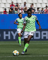 GRENOBLE, FRANCE - JUNE 12: Chidinma Okeke #20 of the Nigerian National Team dribbles during a game between Korea Republic and Nigeria at Stade des Alpes on June 12, 2019 in Grenoble, France.