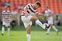 Houston, TX -  Sunday, December 11, 2016: Tomas Hilliard-Acre (4) of the Stanford Cardinal gains control of a loose ball in the first half against the Wake Forest Demon Deacons at the  NCAA Men's Soccer Finals at BBVA Compass Stadium.