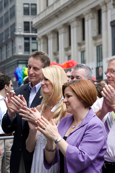 Sandra Lee (C) and City Council Speaker Christine Quinn (L) listen to Governor Andrew Cuomo speak prior to the 2011 NYC Pride March on 26 June 2011 in New York, New York, two days after the New York State Senate voted 33-29 to legalize gay marriage.