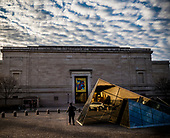 Woman with cane, A woman walks by IM Pei's pyramid outside of the Naitonal Galllery of Art in Washington DC. 15 January 2017.