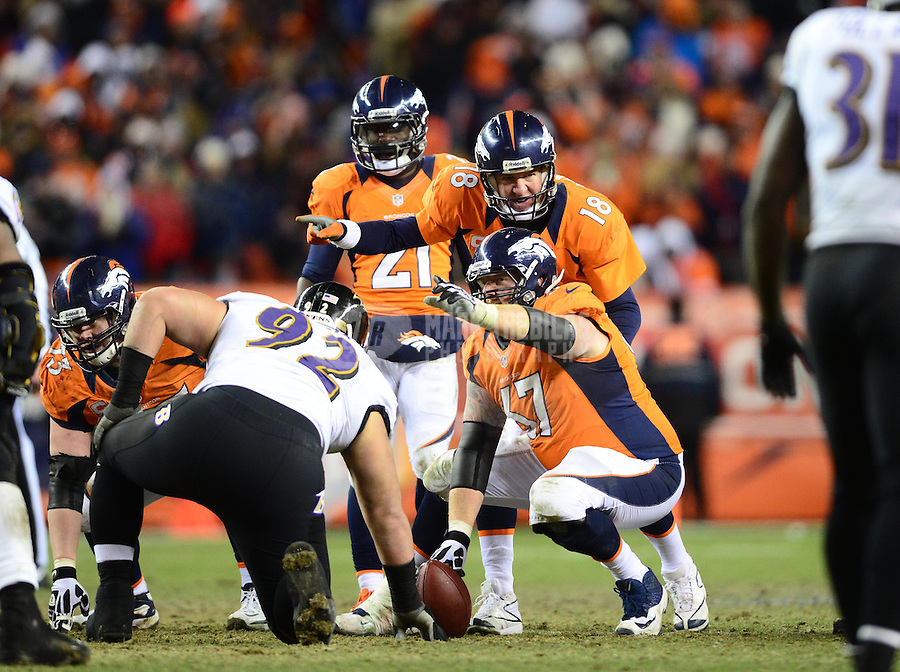 Jan 12, 2013; Denver, CO, USA; Denver Broncos quarterback Peyton Manning (18) talks with center Dan Koppen (67) against the Baltimore Ravens during the AFC divisional round playoff game at Sports Authority Field.  Mandatory Credit: Mark J. Rebilas-