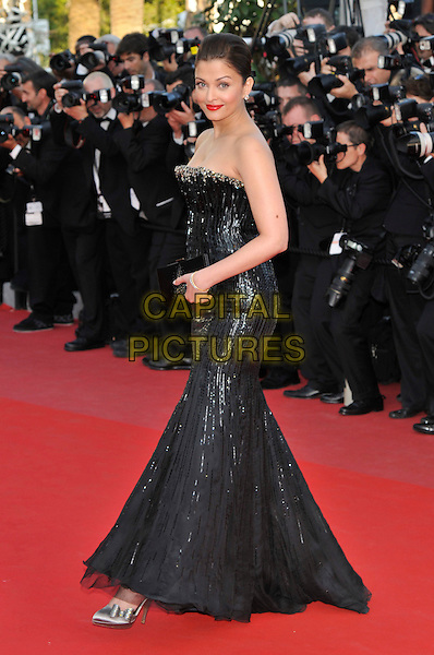 AISHWARYA RIA.wearing Armani Prive .Attending the 'On Tour' premiere during the 63rd International Cannes Film Festival, Cannes, France,.12th May 2010..arrivals full length strapless black sequined sequin long maxi train  clutch bag dress silver shoe side .CAP/PL.©Phil Loftus/Capital Pictures.