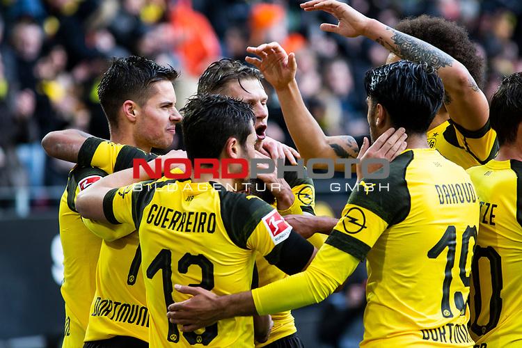 09.02.2019, Signal Iduna Park, Dortmund, GER, 1.FBL, Borussia Dortmund vs TSG 1899 Hoffenheim, DFL REGULATIONS PROHIBIT ANY USE OF PHOTOGRAPHS AS IMAGE SEQUENCES AND/OR QUASI-VIDEO<br /> <br /> im Bild | picture shows:<br /> Raphael Guerreiro (Borussia Dortmund #13), Julian Weigl (Borussia Dortmund #33), Lukasz Piszczek (Borussia Dortmund #26) und Mahmoud Dahoud (Borussia Dortmund #19) jubeln mit dem Torschützen Jadon Sancho (Borussia Dortmund #7) über dessen Treffer zum 1:0,  <br /> <br /> Foto © nordphoto / Rauch