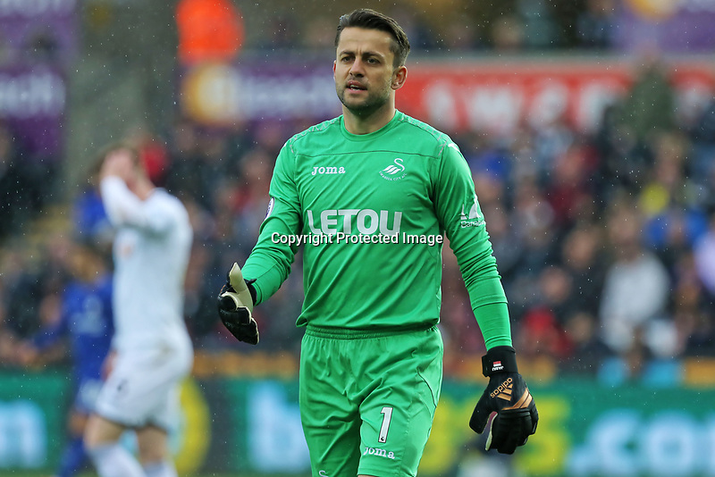Lukasz Fabianski of Swansea City during the English Premier League soccer match between Swansea City and FC Chelsea at the Liberty Stadium, Swansea, Wales, Britain, 28 April 2018. EPA/DIMITRIS LEGAKIS <br /> EDITORIAL USE ONLY. No use with unauthorized audio, video, data, fixture lists, club/league logos or 'live' services. Online in-match use limited to 75 images, no video emulation. No use in betting, games or single club/league/player publications