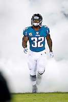 October 24, 2011:  Jacksonville Jaguars running back Maurice Jones-Drew (32) enters the field through a cloud of smoke during player introductions before the start of action between the Jacksonville Jaguars and the Baltimore Ravens played at EverBank Field in Jacksonville, Florida.  ........