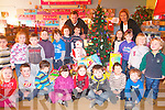 Children from Raheen Montessori playgroup helped collect toys for the 2FM Toy appeal this year and these were collected by Denis Daly Director of Daly's Supervalue who supported the 2FM toy appeal. .Front L-R Aoife Doyle, Mark Brosnan, Tomas Mackey, Elizabeth Roche, Rebecca O'Leary, Eoin Reen Oisin Butler and Lee Kelly .Middle L-R Evan O'Sullivan, Niamh Cantillon, Sean Forrestal, Oscar Lovett, Eoin O'Sullivan, Sarah Griffin, John Scannell, Clodagh McCarthy, Maura O'Sullivan, Bobby Keane and Adam Hobbs. .Back L-R Denis Daly of Daly's Supervalue Killarney and Manager of Raheen Montessori playgroup Lorena O'Connor.