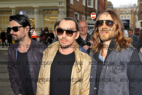 30 Seconds to Mars - Shannon Leto, Tomo Milicevic, Jared Leto - perform an impromptu concert to 500 fans in Soho Square London UK - 30 May 2013.  Photo credit: Zaine Lewis/IconicPix