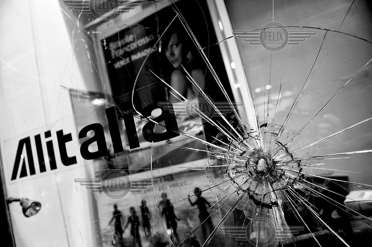 A bullet hole in the glass of a travel agent shop in the Quartieri Spagnoli (Spanish Quarters).