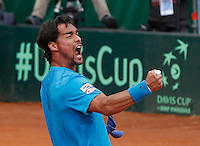 Italy's Fabio Fognini celebrates  after winning his   Davis Cup quarter-final tennis match against Britain's Andy Murray in Naples April 6, 2014.