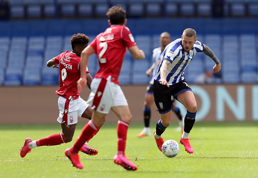 heffield Wednesday's Connor Wickham under pressure from Nottingham Forest's Nuno Da Costa<br /> <br /> Photographer Rich Linley/CameraSport<br /> <br /> The EFL Sky Bet Championship - Sheffield Wednesday v Nottingham Forest - Saturday 20th June 2020 - Hillsborough - Sheffield <br /> <br /> World Copyright © 2020 CameraSport. All rights reserved. 43 Linden Ave. Countesthorpe. Leicester. England. LE8 5PG - Tel: +44 (0) 116 277 4147 - admin@camerasport.com - www.camerasport.com