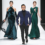 Fashion designer Walter Mendez walks runway with models for the close of his Walter Mendez Fall Winter 2015 collection fashion show, for the Art Hearts Fashion Fall 2015 runway show, during Mercedes-Benz Fashion Week Fall 2015 in New York City.