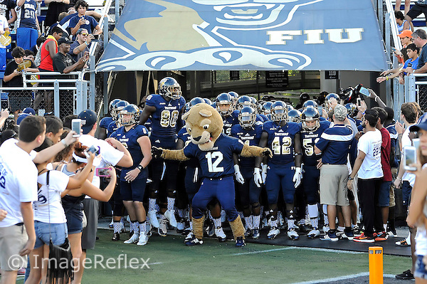 19 September 2015:  Roary and the FIU Football Team prepare to take the field prior to the game as the FIU Golden Panthers defeated the North Carolina Central University Eagles, 39-14, at FIU Stadium in Miami, Florida.