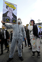 GERMANY Hamburg 2011 march 26 , large rally and meeting at townhall market against nuclear power after accident Fukushima in Japan, poster with caricature of Angela Merkel and slogan: nuclear power is unsexy