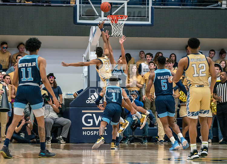 WASHINGTON, DC - FEBRUARY 8: Ace Stallings #20 of George Washington shoots over Jacob Toppin #21 of Rhode Island during a game between Rhode Island and George Washington at Charles E Smith Center on February 8, 2020 in Washington, DC.