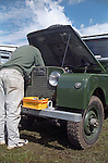 A Land Rover owner servicing his motor at the 1998 Land Rover Series 1 Club event in Shugborough, UK. NO RELEASES AVAILABLE. Automotive trademarks are the property of the trademark holder, authorization may be needed for some uses.