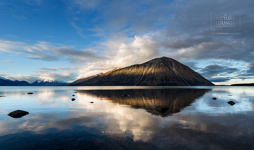 A spectacular place in any season, lovely Lake Ohau is a little off the beaten trail, but this just adds to its allure. The mountain of Ben Ohau is such an iconic feature of the region and has been captured so beautifully in dappled light here by Wanaka-based outdoor photographer Christopher David Thompson.