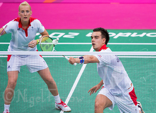 28 JUL 2012 - LONDON, GBR - Chris Adcock (GBR) of Great Britain returns during the London 2012 Olympic Games mixed doubles group match with partner Imogen Bankier (GBR) against Alexandr Nikolaenko and Valeria Sorokina of Russia at Wembley Arena, London, Great Britain (PHOTO (C) 2012 NIGEL FARROW)