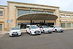 White taxis outside railway station building, Caceres, Extremadura, Spain