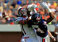 Richmond defensive back Ayo Ogunniyi (9) breaks up the pass intended for Virginia wide receiver Andre Levrone (14) during the game Saturday Sept. 6, 2014 at Scott Stadium in Charlottesville, VA. Virginia defeated Richmond 45-13. Photo/Andrew Shurtleff