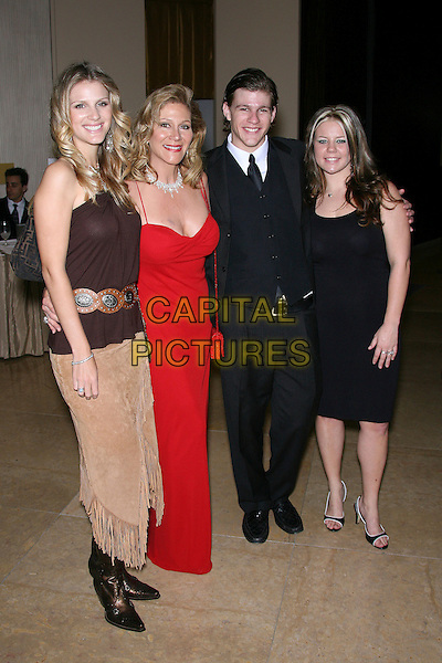 JENNIFER WAYNE, AISSA WAYNE, NICK WAYNE & KELLI WILLIAMS.The John Wayne Cancer Institute Auxiliary 21st Annual Odyssey Ball held at the Beverly Hilton Hotel, Beverly Hills, California, USA, 8th April 2006..full length family.Ref: ADM/ZL.www.capitalpictures.com.sales@capitalpictures.com.©Zach Lipp/AdMedia/Capital Pictures.