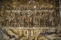 Azerbaijan. Baku Region. Baku. Dagustu Park. Destroyed monument after the fall of Soviet Union. Derelict statue with old communist symbols, celebrating the 1917 revolution. © 2007 Didier Ruef