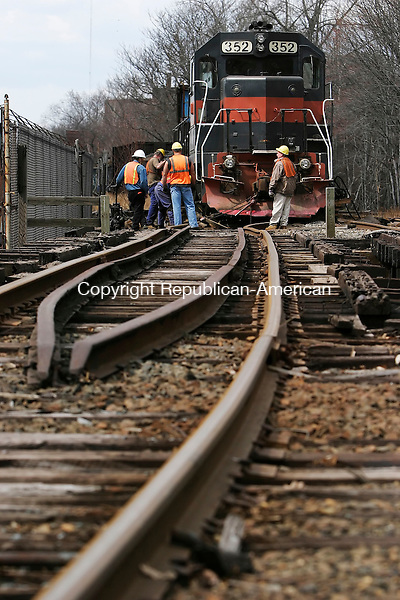 WATERBURY, CT, 13 April 2006- 041306BZ12- Workers try to get a derailed freight train back on the tracks near Freight Street in Waterbury<br /> Thursday afternoon.<br /> Jamison C. Bazinet Republican-American