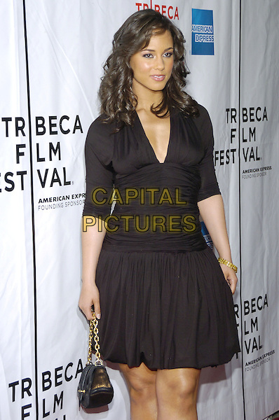 "ALICIA KEYS.6th Annual Tribeca Film Festival - ""We Are Together (Thina Simunye)"", An HBO Documentary Film, New York City, New York, USA..April 26th, 2007.half length black dress .CAP/ADM/BL.©Bill Lyons/AdMedia/Capital Pictures"